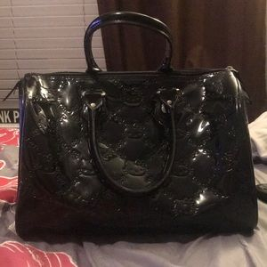 99b70cd6c86f Hello Kitty Bags - Hello Kitty Black Patent Embossed City Bag!